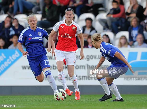 Natalia De Pablos Sanchon of Arsenal takes on Katie Chapman and Gilly Flaherty of Chelsea during the match between Arsenal Ladies and Chelsea Ladies...