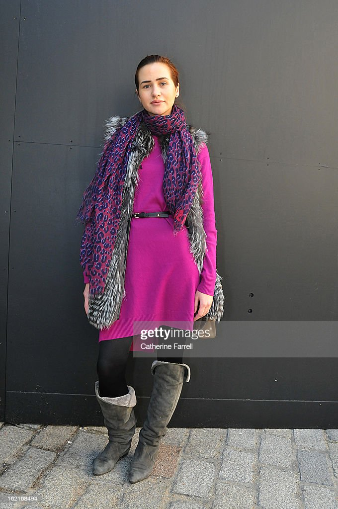 Natalia Dombrovska wears a silver fox fur gilet, a Louis Vuitton scarf, and Diane von Furstenberg dress accessorised by a Forever 21 belt, Wolford tights,Fendi bag, and Brian Edwards boots at London Fashion Week Fall/Winter 2013/14 on February 19, 2013 in London, England.