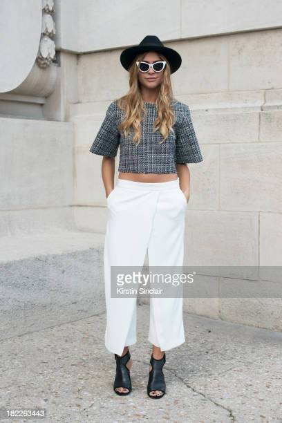 Natalia Georgala wears a vintage hat Front Row Shop top Zara trousers vintage sunglasses and Senso shoes on day 5 of Paris Fashion Week Spring/Summer...