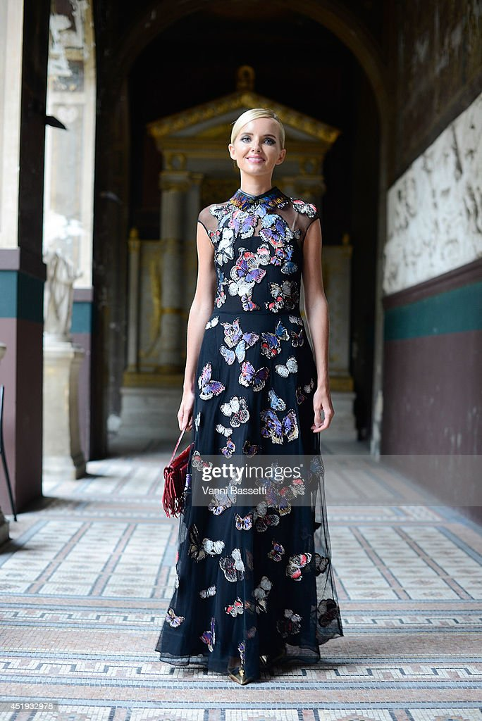 Natalia Kim poses wearing a Valentino dress after Vionnet show on July 9, 2014 in Paris, France.
