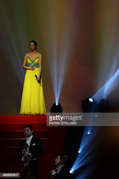 Natalia Klitschko wife of Vitali Klitschko sings the Ukrainian national anthem prior to the WBA IBF WBO and IBO title bout between Ukrainian World...