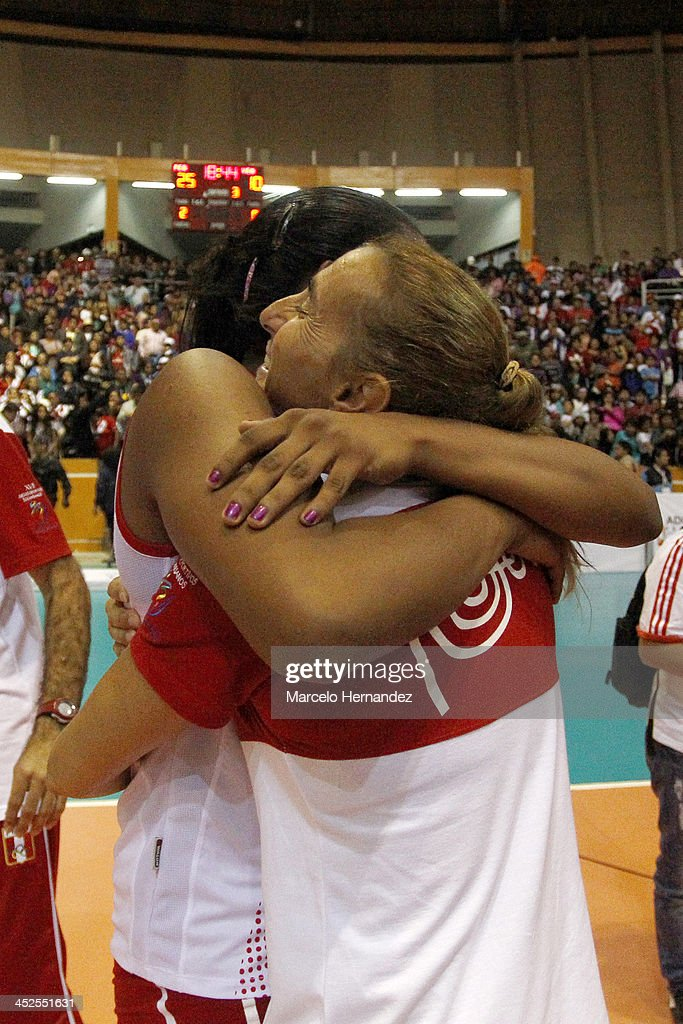 Natalia Malaga coach of Peru celebrates after the end game against Venezuela in women's volleyball as part of the XVII Bolivarian Games Trujillo 2013 at Coliseo gran Chimu on November 25, 2013 in Trujillo, Peru.