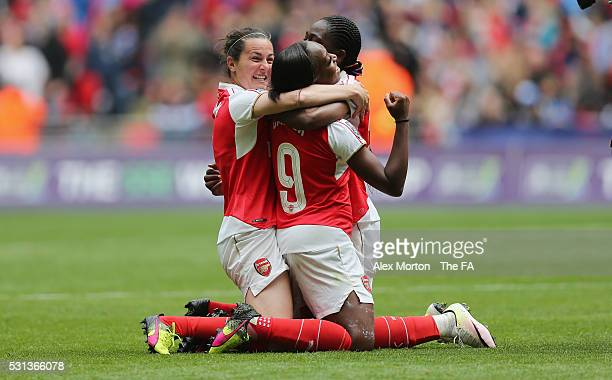 Natalia Pablos Sanchon Dan carter and Asisat Oshoala celebrate victory over Chelsea during the SSE Women's FA Cup Final between Arsenal Ladies and...