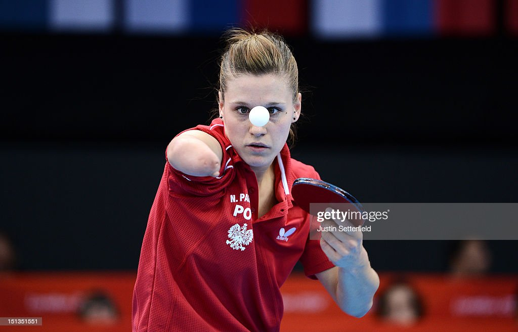 <a gi-track='captionPersonalityLinkClicked' href=/galleries/search?phrase=Natalia+Partyka&family=editorial&specificpeople=5489382 ng-click='$event.stopPropagation()'>Natalia Partyka</a> of Poland in action during the Women's Team Table Tennis - Classes 6-10 quarter-final match against Bruna Alexandre of Brazil on Day 8 of the London 2012 Paralympic Games at ExCeL on September 6, 2012 in London, England.
