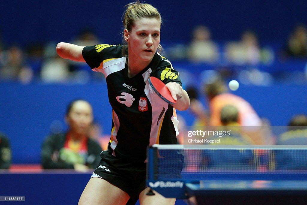 <a gi-track='captionPersonalityLinkClicked' href=/galleries/search?phrase=Natalia+Partyka&family=editorial&specificpeople=5489382 ng-click='$event.stopPropagation()'>Natalia Partyka</a> of Poland plays a backhand during her match against Irene Ivancan of Germany during the LIEBHERR table tennis team world cup 2012 championship division group C women's team match between Poland and Germany at Westfalenhalle Dortmund on March 25, 2012 in Dortmund, Germany.