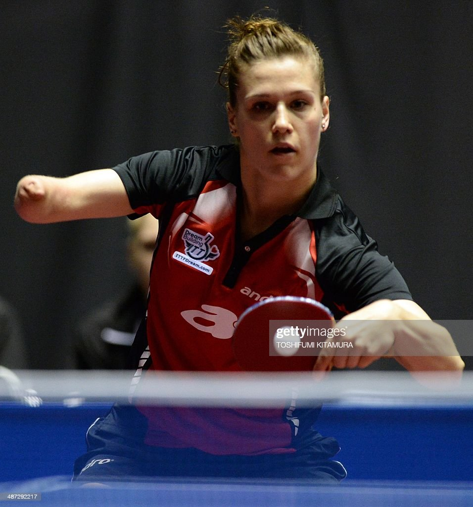 <a gi-track='captionPersonalityLinkClicked' href=/galleries/search?phrase=Natalia+Partyka&family=editorial&specificpeople=5489382 ng-click='$event.stopPropagation()'>Natalia Partyka</a> of Poland returns the ball towards Kim Jong of North Korea during their women's singles round three match of the 2014 World Team Table Tennis Championships in Tokyo on April 29, 2014. AFP PHOTO/Toshifumi KITAMURA