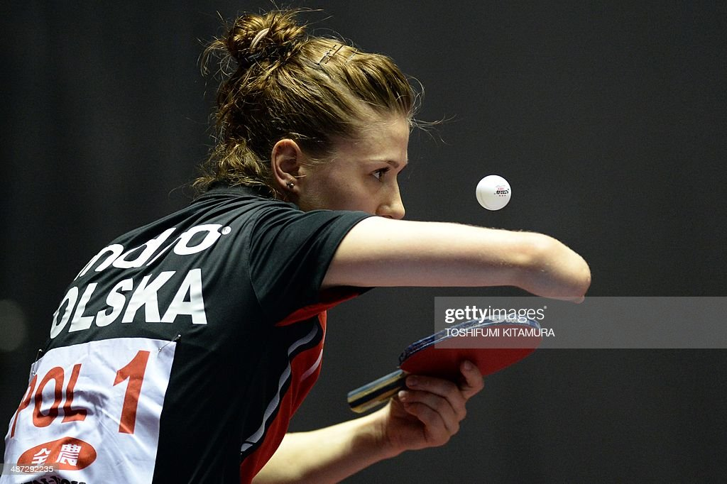 <a gi-track='captionPersonalityLinkClicked' href=/galleries/search?phrase=Natalia+Partyka&family=editorial&specificpeople=5489382 ng-click='$event.stopPropagation()'>Natalia Partyka</a> of Poland serves the ball towards Kim Jong of North Korea during their women's singles round three match of the 2014 World Team Table Tennis Championships in Tokyo on April 29, 2014. AFP PHOTO/Toshifumi KITAMURA