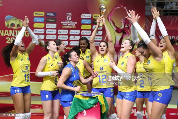 Natalia Pereira and team mates of Brazil celebrate with trophy after winning the final match between Brazil and Italy during 2017 Nanjing FIVB World...