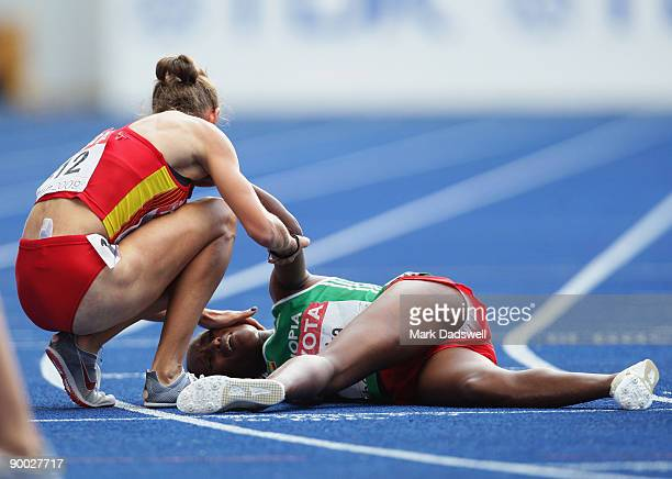 Natalia Rodriguez of Spain stands over Gelete Burka of Ethiopia in the women's 1500 Metres Final during day nine of the 12th IAAF World Athletics...