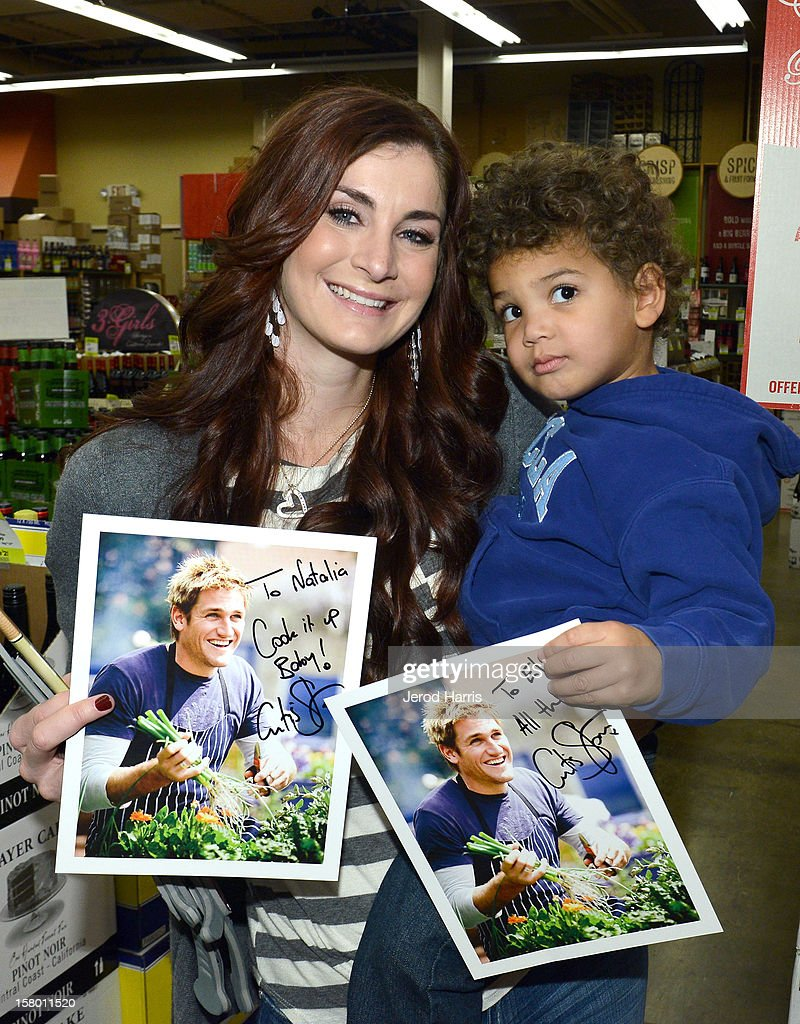 Natalia Simmons and son Eli Simmons show off their autographed pictures of Celebrity Chef Curtis Stone at Cost Plus World Market's Share the Joy event with celebrity chef Curtis Stone at Cost Plus World Market on December 8, 2012 in Los Angeles, United States.