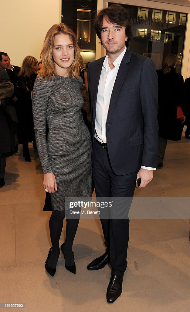 Natalia Vodianova (L) and Antoine Arnault attend a private view of 'Mat Collishaw: This Is Not An Exit' at Blaine/Southern Gallery on February 13, 2013 in London, England.