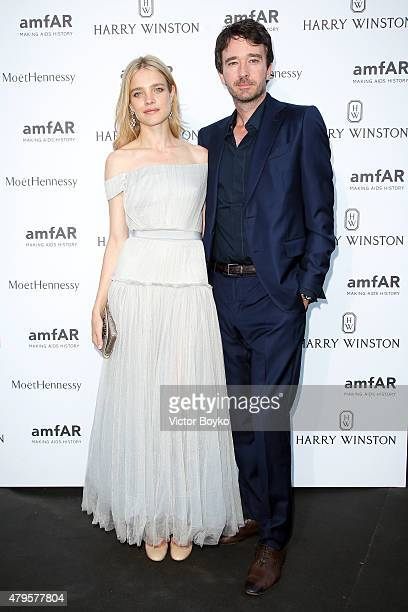 Natalia Vodianova and Antoine Arnault attend the amfAR dinner at the Pavillon LeDoyen during the Paris Fashion Week Haute Couture on July 5 2015 in...