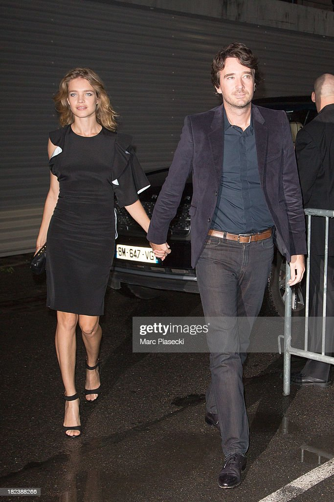 Natalia Vodianova and Antoine Arnault attend the 'Givenchy' show as part of the Paris fashion week Womenswear 2014 at the Halle Freyssinet on...