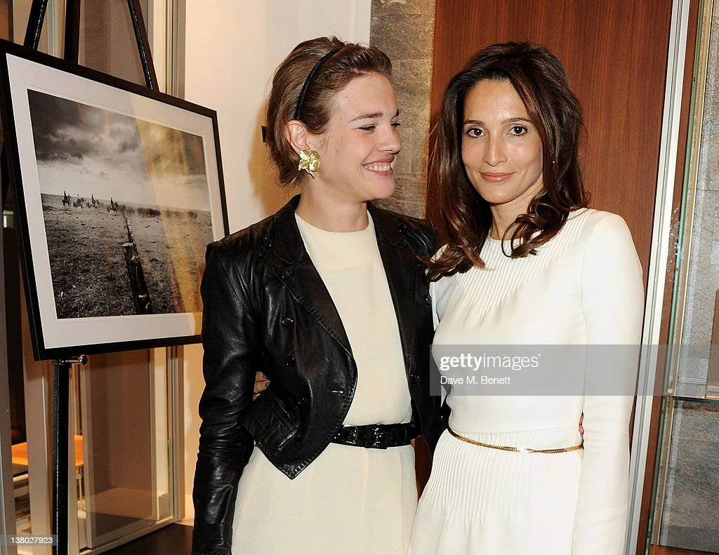 Natalia Vodianova (L) and Astrid Munoz attend a private viewing of 'Gaucho', a photographic exhibition by Astrid Munoz, at the Jaeger-LeCoultre Boutique on January 31, 2012 in London, England.