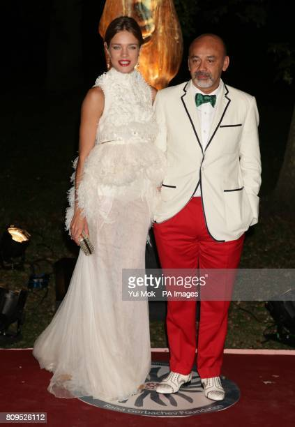 Natalia Vodianova and Christian Louboutin arriving for the annual Raisa Gorbachev Foundation Gala at Hampton Court Palace in London