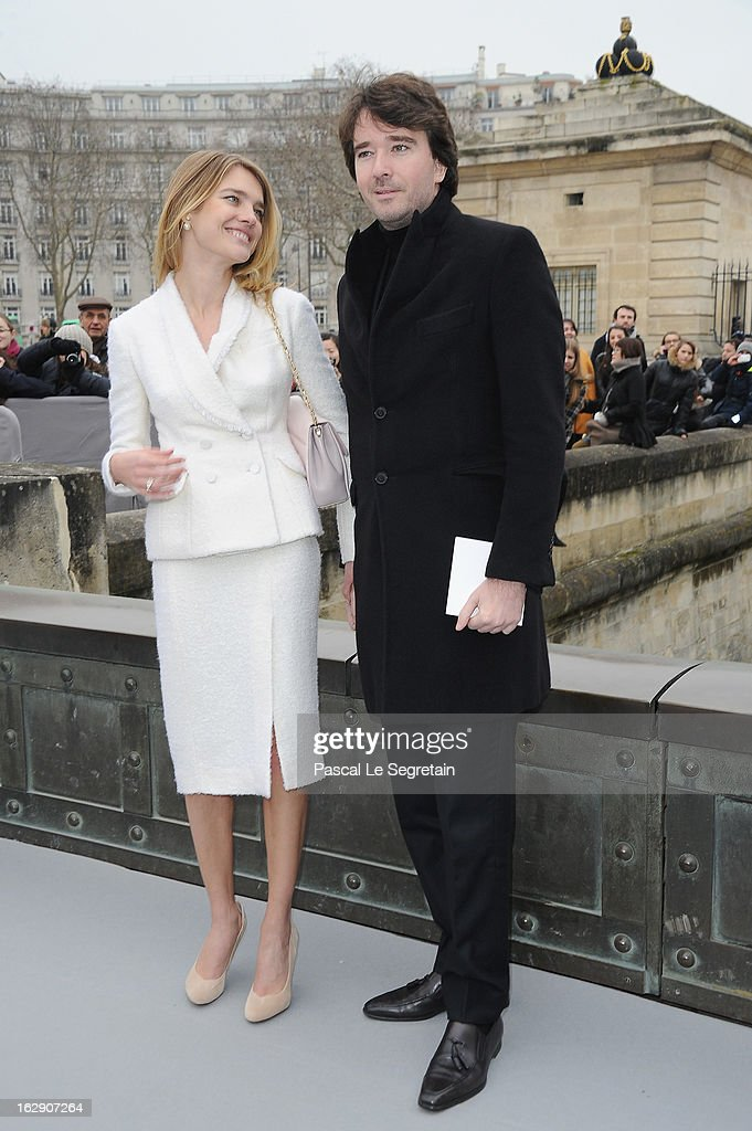 Natalia Vodianova (L) and companion Antoine Arnault arrive to atttend the Christian Dior Fall/Winter 2013 Ready-to-Wear show as part of Paris Fashion Week on March 1, 2013 in Paris, France.