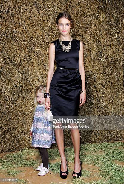 Natalia Vodianova and daughter attend the Chanel Pret a Porter show as part of the Paris Womenswear Fashion Week Spring/Summer 2010 at the Grand...