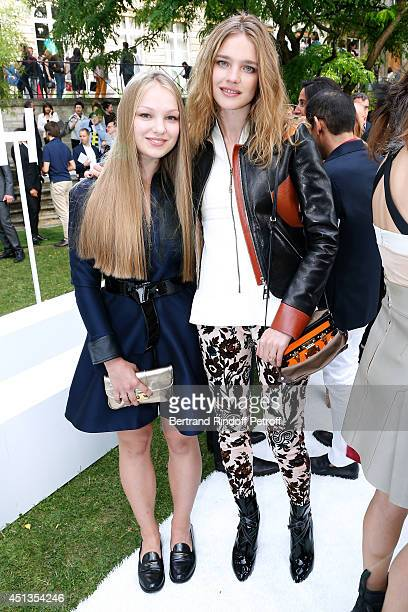 Natalia Vodianova and her sister Kristina Kusakina attend the Berluti show as part of the Paris Fashion Week Menswear Spring/Summer 2015 Held at...