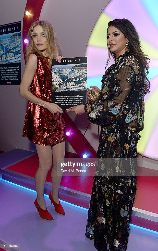Natalia Vodianova (L) and prize winner at The Naked Heart Foundation's Fabulous Fund Fair in London at Old Billingsgate Market on February 20, 2016 in London, England.