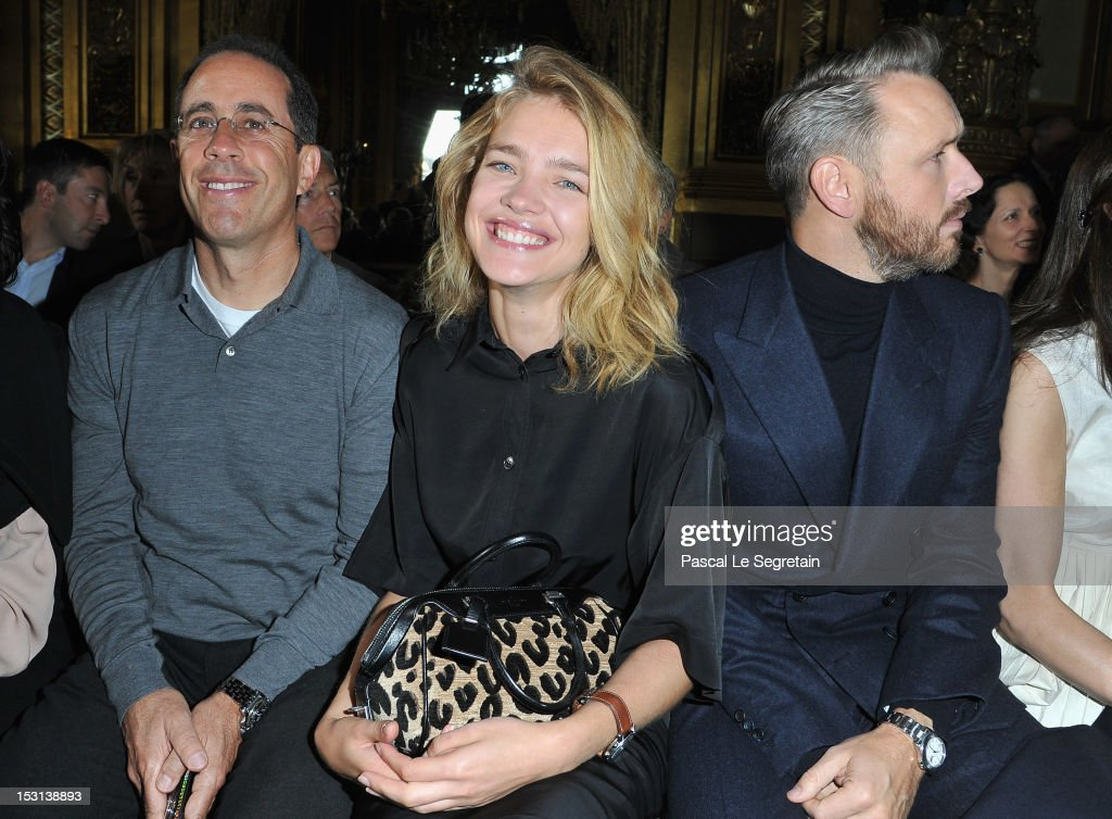 <a gi-track='captionPersonalityLinkClicked' href=/galleries/search?phrase=Natalia+Vodianova&family=editorial&specificpeople=203265 ng-click='$event.stopPropagation()'>Natalia Vodianova</a> (C) attends the Stella McCartney Spring / Summer 2013 show as part of Paris Fashion Week on October 1, 2012 in Paris, France.