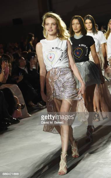 Natalia Vodianova Bella Hadid and Kendall Jenner walk the runway at the Fashion for Relief event during the 70th annual Cannes Film Festival at...