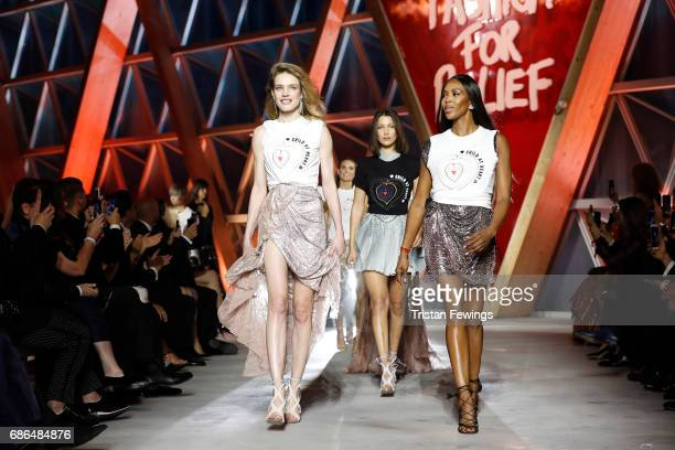 Natalia Vodianova Bella Hadid and Naomi Campbell walk the runway at the Fashion for Relief event during the 70th annual Cannes Film Festival at...