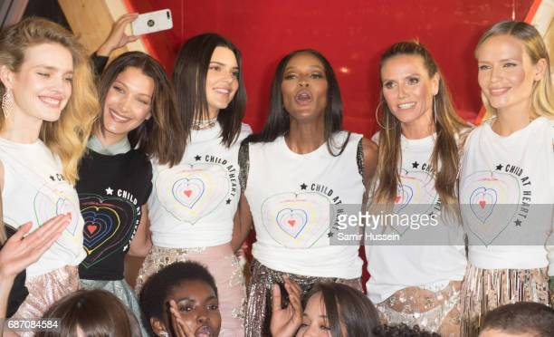 Natalia Vodianova Bella Hadid Kendall Jenner Naomi Campbell Heidi Klum walk the runway at the Fashion for Relief event during the 70th annual Cannes...