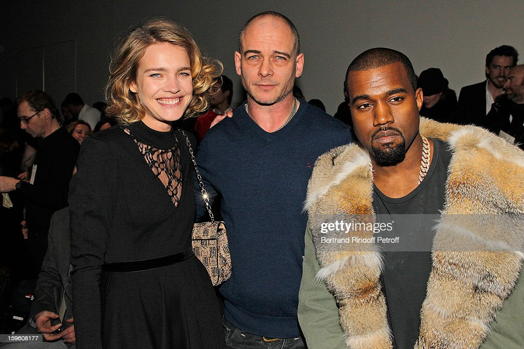 Natalia Vodianova, Dinos Chapman and Kanye West attend the Louis Vuitton Men Autumn / Winter 2013 show as part of Paris Fashion Week on January 17, 2013 in Paris, France.
