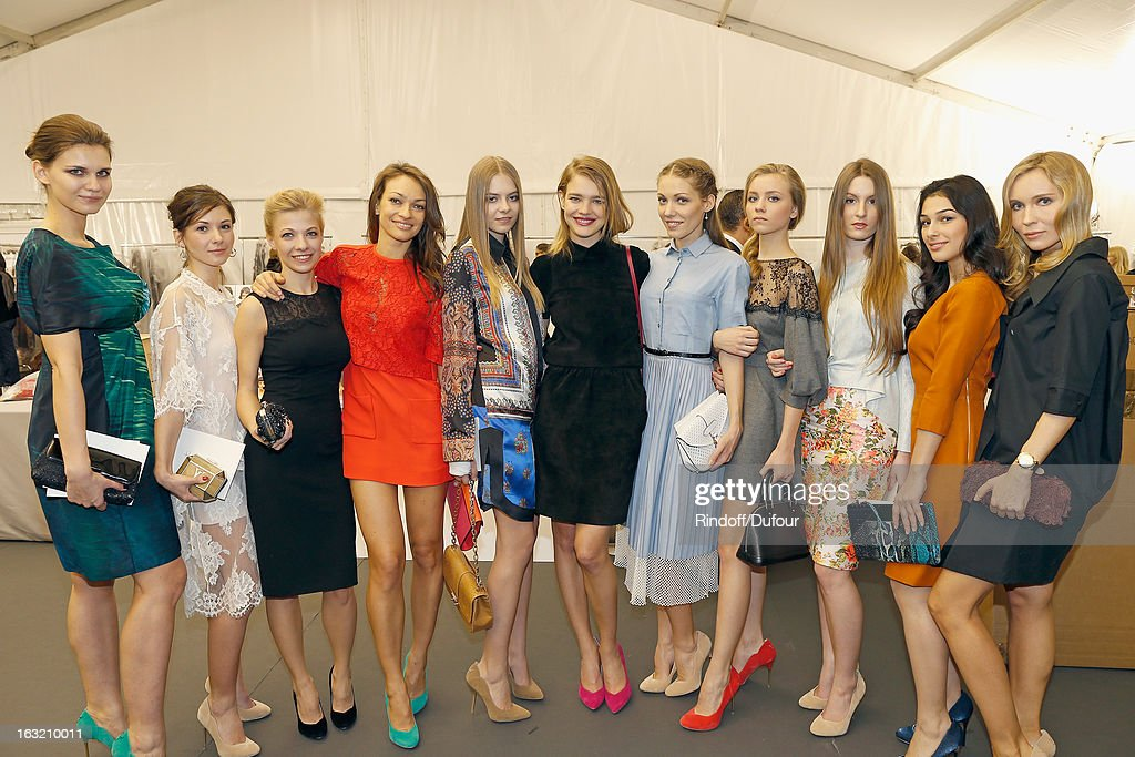Natalia Vodianova (C) poses with women she teamed up with, for her charity project 'Fairytale by Centro for Naked Heart Foundation', following the Louis Vuitton Fall/Winter 2013 Ready-to-Wear show as part of Paris Fashion Week on March 6, 2013 in Paris, France.