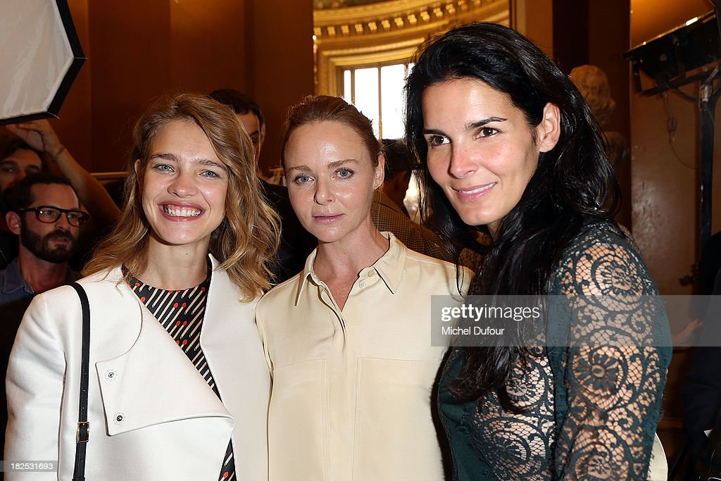 <a gi-track='captionPersonalityLinkClicked' href=/galleries/search?phrase=Natalia+Vodianova&family=editorial&specificpeople=203265 ng-click='$event.stopPropagation()'>Natalia Vodianova</a>, Stella McCartney and <a gi-track='captionPersonalityLinkClicked' href=/galleries/search?phrase=Angie+Harmon&family=editorial&specificpeople=204576 ng-click='$event.stopPropagation()'>Angie Harmon</a> attend the Stella McCartney show as part of the Paris Fashion Week Womenswear Spring/Summer 2014 on September 30, 2013 in Paris, France.