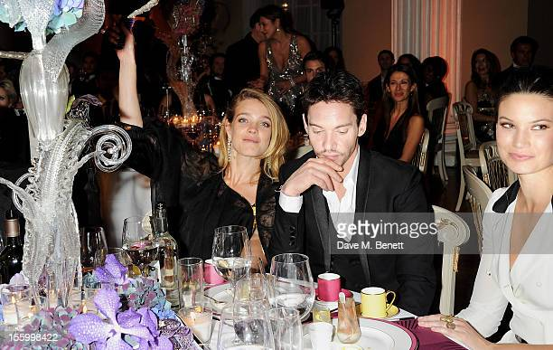 Natalia Vodianova wearing Star Diamond Jonathan Rhys Meyers and Victoria KeonCohen attend the Place For Peace dinner cohosted by Ella Krasner and...