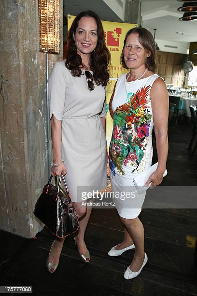 Natalia Woerner and Christina Rau attends the DKMS LIFE Charity Ladies lunch at Soho House on August 8 2013 in Berlin Germany