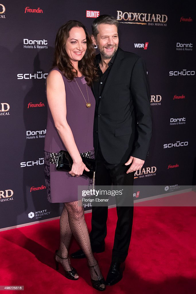 Natalia Woerner and Kai Wiesinger attend the 'Bodyguard Das Musical' gala premiere at Musical Dome Koeln on November 21 2015 in Cologne Germany
