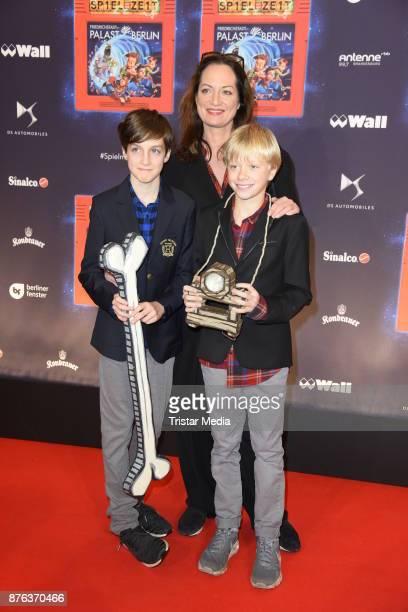 Natalia Woerner her son Jacob Seeliger and his friend Oskar attend the premiere of the children show 'Spiel mit der Zeit' at Friedrichstadtpalast on...