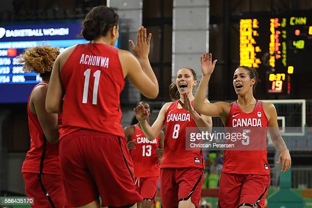 Natalie Achonwa Kim Gaucher and Kia Nurse of Canada celebrate after scoring against China during a Women's Basketball Preliminary Round game on Day 1...