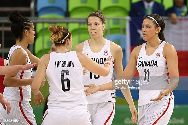 Natalie Achonwa of Canada high fives Shona Thorburn after scoring against United States during the women's basketball game on Day 7 of the Rio 2016...