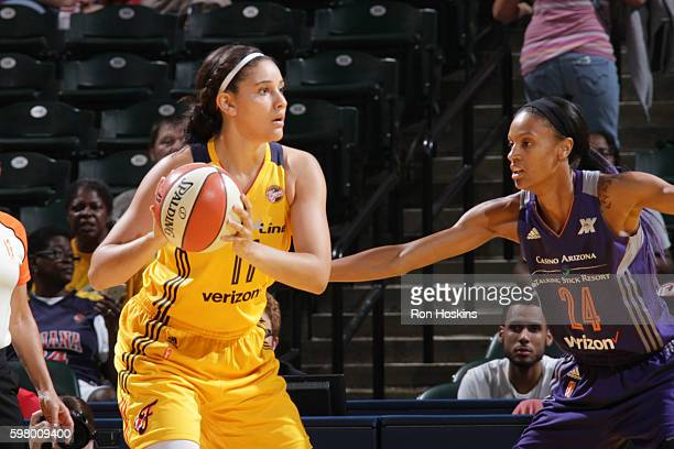 Natalie Achonwa of the Indiana Fever handles the ball against DeWanna Bonner of the Phoenix Mercury on August 30 2016 at Bankers Life Fieldhouse in...