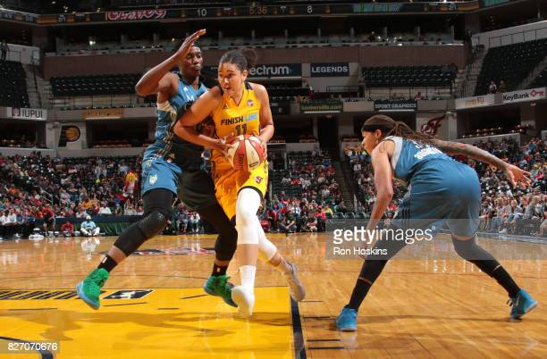 Natalie Achonwa of the Indiana Fever handles the ball against Sylvia Fowles of the Minnesota Lynx on August 6 2017 at Bankers Life Fieldhouse in...