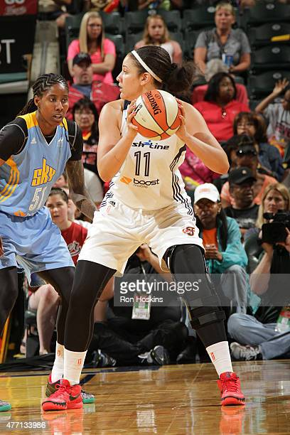 Natalie Achonwa of the Indiana Fever handles the ball against the Chicago Sky on June 14 2015 at Bankers Life Fieldhouse in Indianapolis Indiana NOTE...