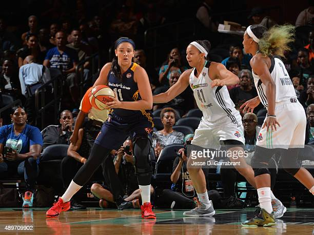 Natalie Achonwa of the Indiana Fever looks to pass the ball against the New York Liberty during game One of the WNBA Eastern Conference Finals at...
