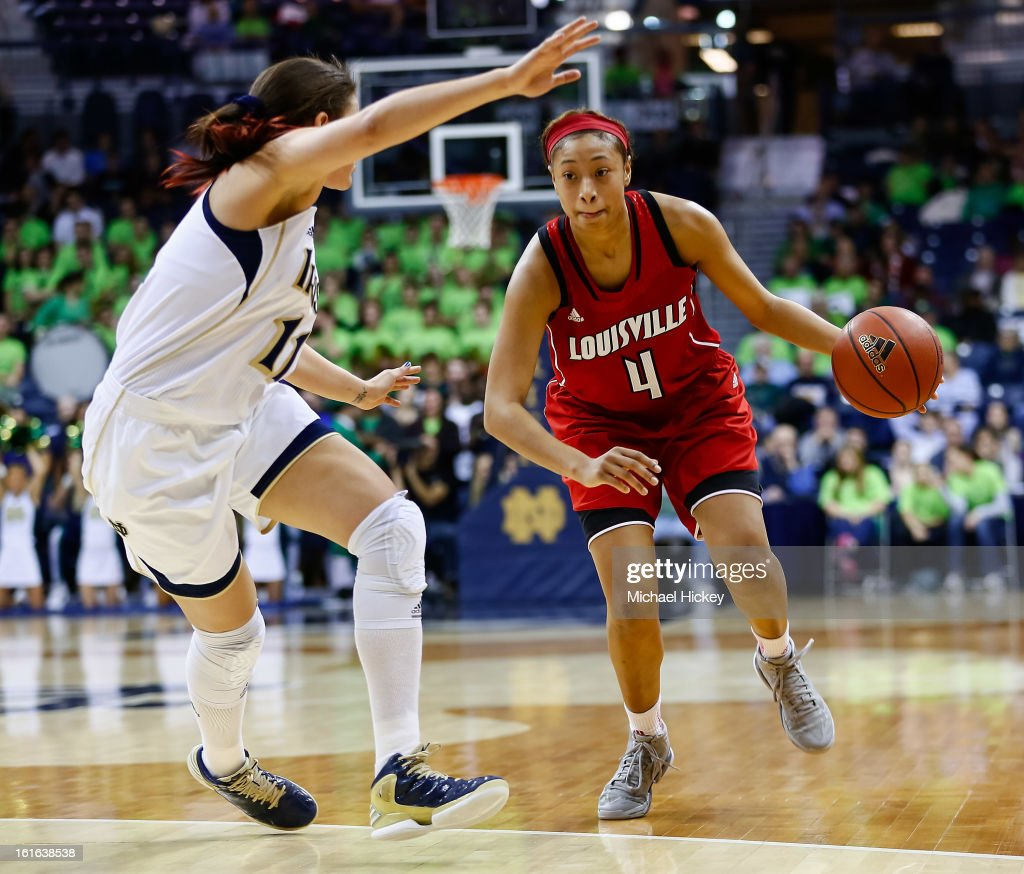 Natalie Achonwa #11 of the Notre Dame Fighting Irish guards as Antonita Slaughter #4 of the Louisville Cardinals dribbles the ball at Purcel Pavilion on February 11, 2013 in South Bend, Indiana. Notre Dame defeated Louisville 93-64.