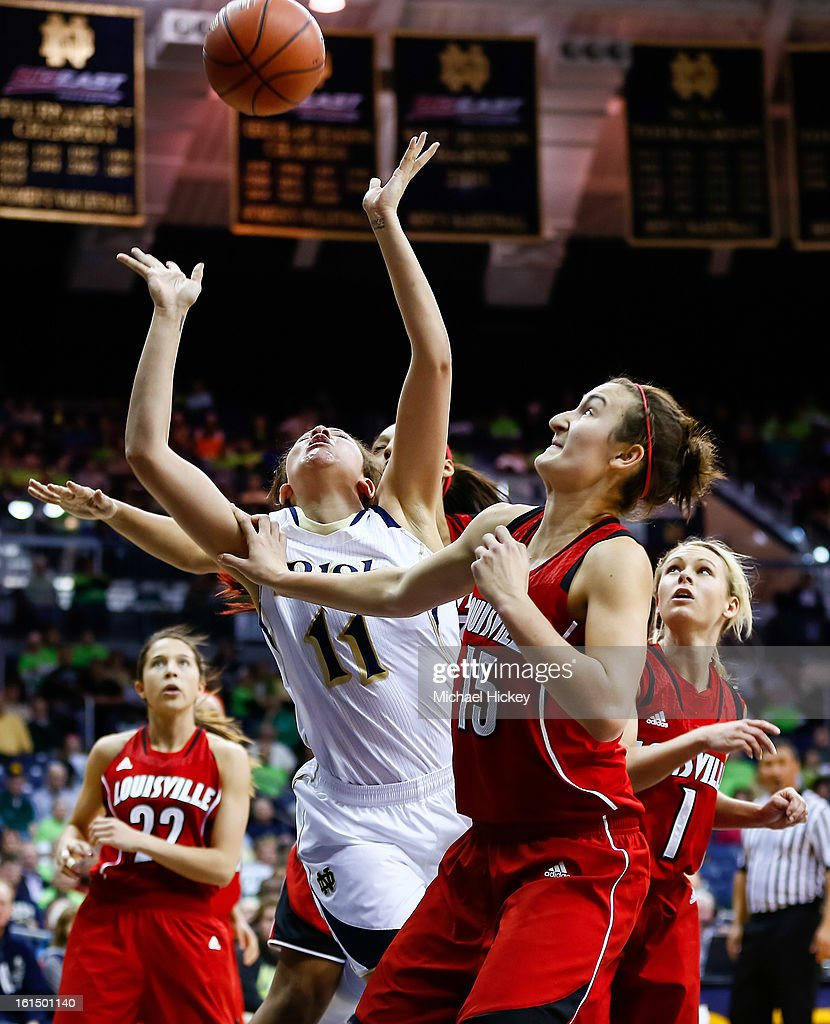Natalie Achonwa #11 of the Notre Dame Fighting Irish loses the ball during a shot as Megan Deines #15 of the Louisville Cardinals looks on at Purcel Pavilion on February 11, 2013 in South Bend, Indiana. Notre Dame defeated Louisville 93-64.