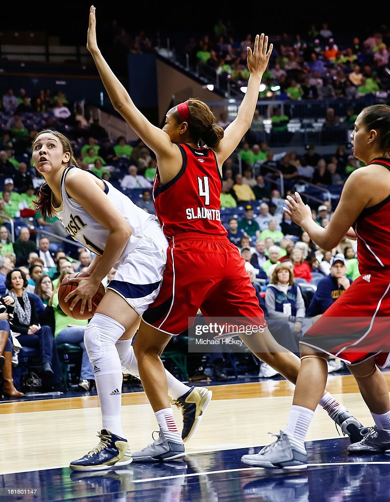 Natalie Achonwa #11 of the Notre Dame Fighting Irish makes a move to the basket as Antonita Slaughter #4 of the Louisville Cardinals at Purcel Pavilion on February 11, 2013 in South Bend, Indiana. Notre Dame defeated Louisville 93-64.