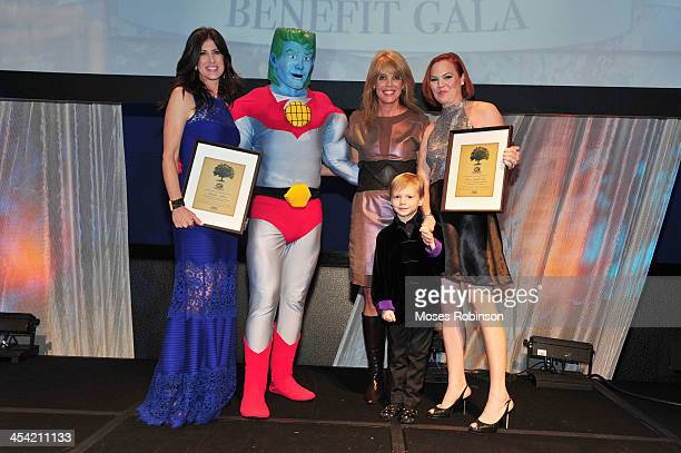 Natalie Allen Captain Planet Laura Turner Seydel Guest and Cara Isdell Lee attend the Captain Planet Foundation benefit gala at Georgia Aquarium on...