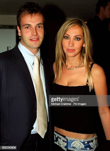 Natalie Appleton from the girl band All Saints wearing a Versace belt with her boyfriend actor Johnny Lee Miller arrive at the Elle Magazine Style...