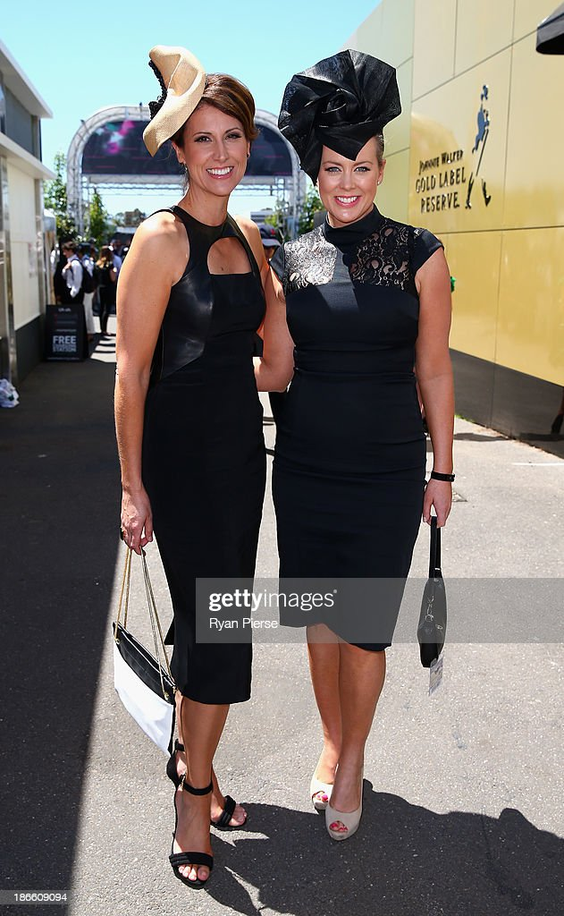 Natalie Barr and Samantha Armytage arrive on Victoria Derby Day at Flemington Racecourse on November 2, 2013 in Melbourne, Australia.