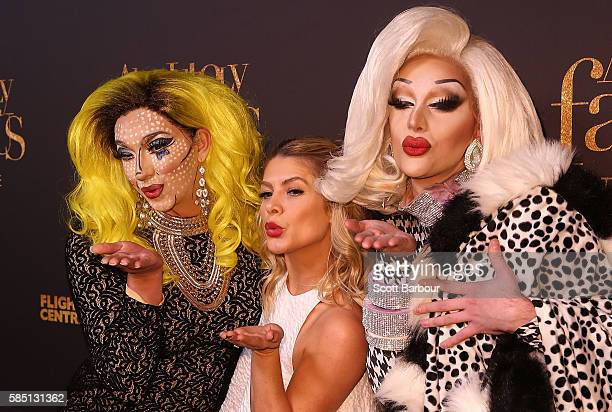 Natalie Bassingthwaighte poses with two drag queens ahead of the Absolutely Fabulous The Movie Melbourne premiere at Village Cinemas Crown on August...