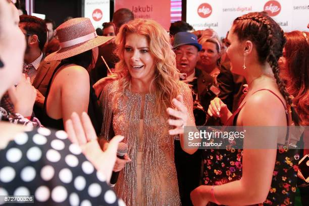 Natalie Bassingthwaighte talks with Olympia Valance after performing at the Sensis Marquee on Stakes Day at Flemington Racecourse on November 11 2017...