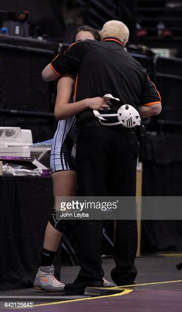 Natalie Benavides of Del Norte gets a hug from assistant coach Ron Beiriger after her loss to Sheridan Harvey of Meeker during their Class 2A 138...