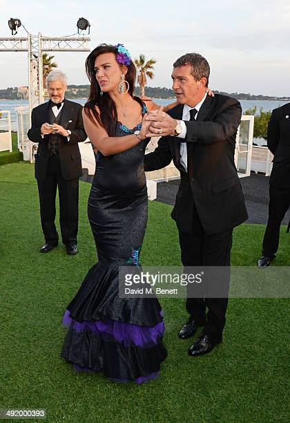 Natalie Burn and Antonio Banderas dance at 'The Expendables 3' private dinner and party at Gotha Night Club at Palm Beach on May 18 2014 in Cannes...